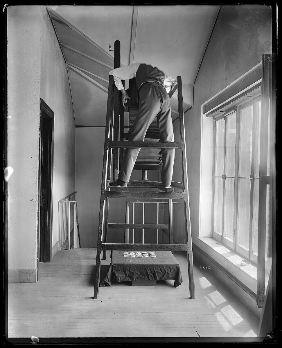 United States National Museum photographer, believed to be Thomas William Smillie, shoots objects from overhead.