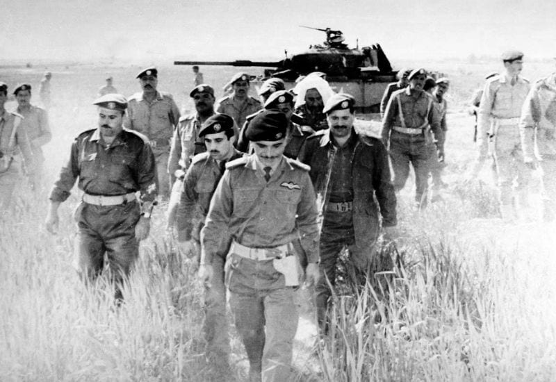 King Hussein after checking an abandoned Israeli tank